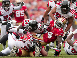 October 11, 2009; San Francisco, CA, USA;  San Francisco 49ers wide receiver Josh Morgan (84) is tackled by Atlanta Falcons defensive end Jamaal Anderson (98), linebacker Stephen Nicholas (54), and defensive end Kroy Biermann (71) in the fourth quarter at Candlestick Park. Atlanta won 45-10.