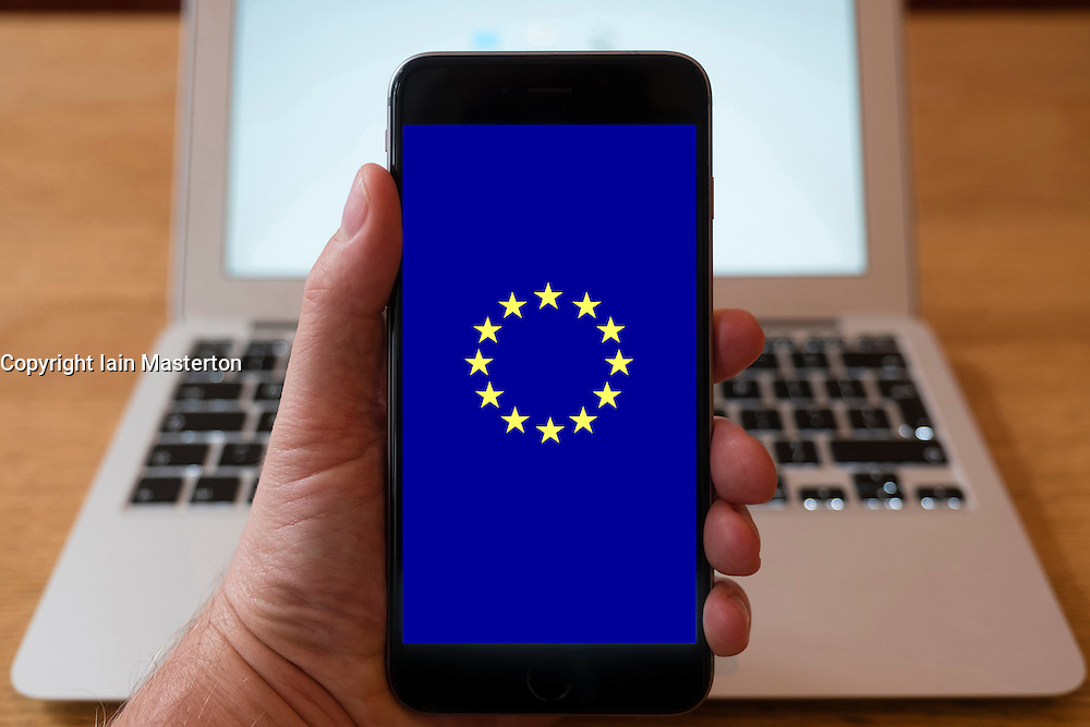 Using iPhone smartphone to display logo of the European Union