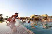 Jordan, Aqaba, Tala Bay Luxury Beach Resort  couple in the pool