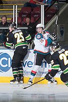 KELOWNA, CANADA - JANUARY 26: Colton Sissons #15 of the Kelowna Rockets is checked by Carson Perreaux #25 of the Prince Albert Raiders at the Kelowna Rockets on January 26, 2013 at Prospera Place in Kelowna, British Columbia, Canada (Photo by Marissa Baecker/Shoot the Breeze) *** Local Caption ***