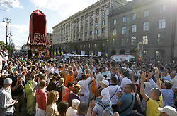 May 26, 2019 - Kiev, Kiev, Ukraine - Hare Krishna devotees are seen pulling a decorative chariot eight meters high during the Ratha-Yatra Carnival of Chariots in Kiev..According to mythology, the Ratha Yatra dates back some 5,000 years when Hindu god Krishna, along with his older brother Balaram and sister Subhadra, were pulled on a chariot from Kurukshetra to Vrindavana by Krishna's devotees. Ratha Yatra also referred to as Rathayatra, Rathajatra or Chariot festival is popular public procession in a chariot, celebrated annually in India and it attracts over a million Hindu pilgrims to join the procession. The central element of the walk is Ratha, a magnificently decorated chariot in the form of a dome, which the participants drag along the street with the help of ropes. It symbolizes the path of the soul towards peace and love. It is believed that everyone who takes a rope will be lucky in life. (Credit Image: © Pavlo Gonchar/SOPA Images via ZUMA Wire)