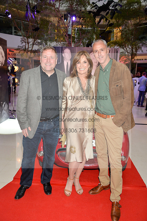 Left to right, DARREN JULIEN, LINDA GRAY and MARTIN NOLAN at a private view of Marilyn - The Legacy of a Legend held at the Design Centre, Chelsea Harbour, London on 25th May 2016.