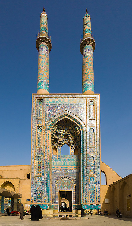The grand iwan of the mosque is crowned by a pair of minarets, the highest in Iran, and the portal's facade is decorated from top to bottom in dazzling tile work, predominantly blue in colour.The J?meh Mosque of Yazd (Persian: ???? ???? ???? - Masjid-e-J?meh Yazd) is the grand, congregational mosque (J?meh) of Yazd, Iran. Built 12-14th Century.