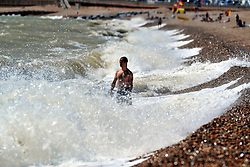 © Licensed to London News Pictures. 17/07/2018<br /> Hastings, UK.<br /> A man cooling off in the sea.<br /> Hot heatwave weather in Hastings on the seafront as people enjoy their day.<br /> Photo credit: Grant Falvey/LNP