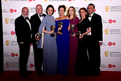 Colin Wratten, Harry Bradbeer, Phoebe Waller-Bridge, Kim Bodnia, Sally Woodward Gentle, Jodie Comer and Fiona Shaw in the press room with the award for Drama Series at the Virgin Media BAFTA TV awards, held at the Royal Festival Hall in London.