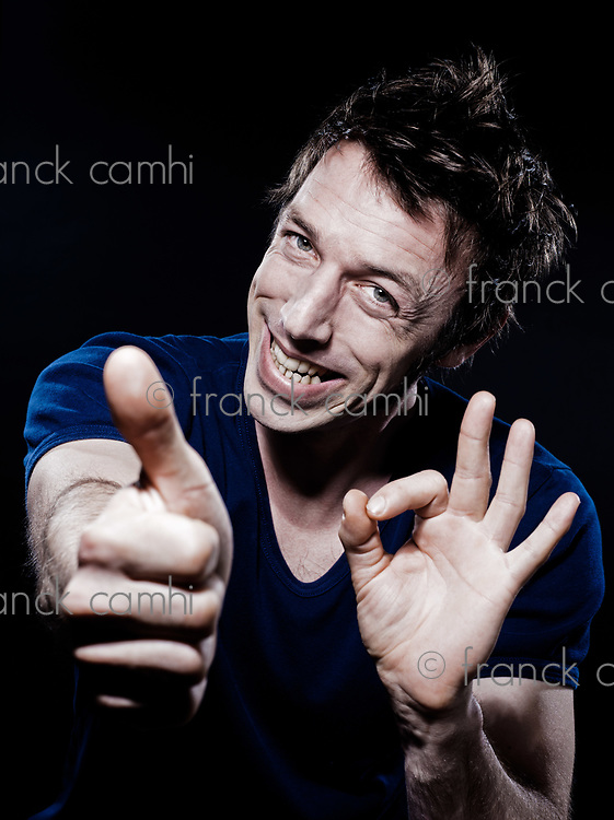 studio portrait on black background of a funny expressive caucasian man