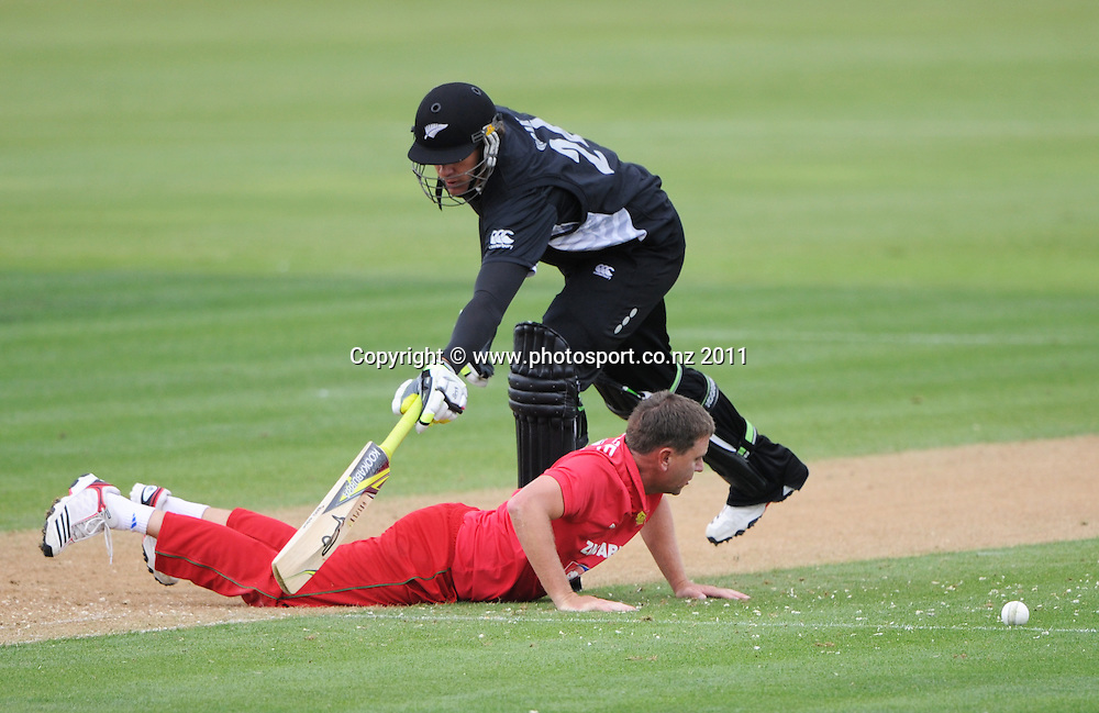 Jacob Oram and Ray Price at the 2nd ODI cricket match between New Zealand and Zimbabwe at Cobham Oval in Whangarei, Monday 6 February 2012. Napier, New Zealand. Photo: Andrew Cornaga/Photosport.co.nz