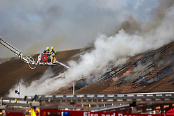 © Licensed to London News Pictures. 06/03/2017. LUTON, UK.  Firefighters tackle a blaze in the roof of an Asda supermarket in Wigmore Lane, Luton.   Photo credit: Cliff Hide/LNP