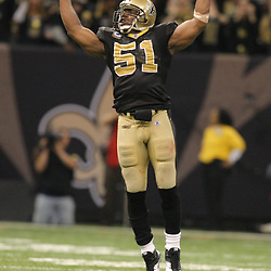Jan 24, 2010; New Orleans, LA, USA; New Orleans Saints linebacker Jonathan Vilma (51) celebrates after cornerback Tracy Porter (not pictured) intercepted a pass against the Minnesota Vikings during the fourth quarter of the 2010 NFC Championship game at the Louisiana Superdome. Mandatory Credit: Derick E. Hingle-US PRESSWIRE