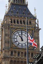 © Licensed to London News Pictures. 25/05/2017. London, UK. Big Ben clock strikes 11am as one minute silence is obsevered for the victims of the Manchester Arena bombing, outside New Scotland Yard in Westminster, London on Thursday, 26 May 2017. Photo credit: Tolga Akmen/LNP