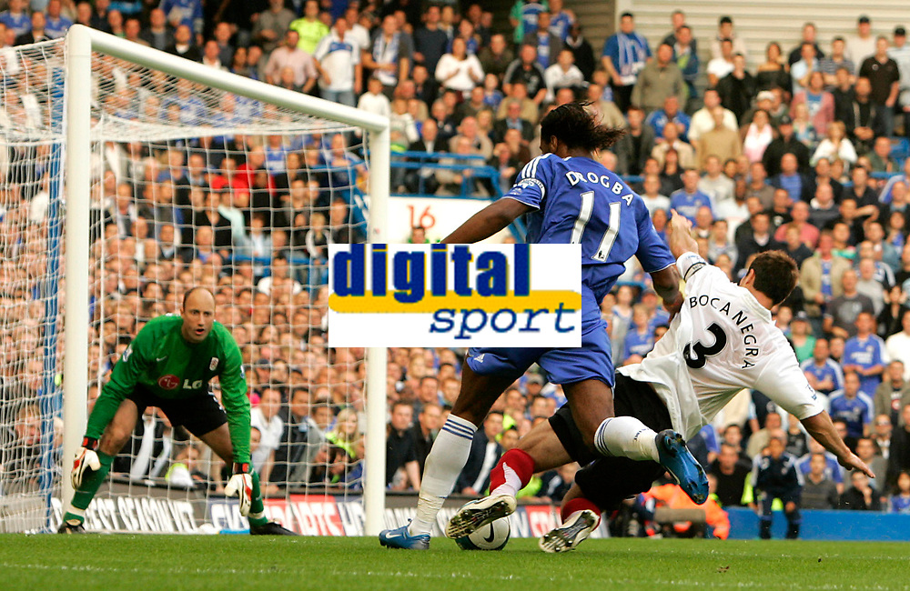 Chelsea v Fulham. Barclays Premier League. 29/09/2007. Didier Drogba of Chelsea has been overpowered by Carlos Bocanegra of Fulham and lost the ball.