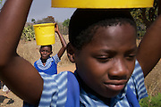 Children at the Mutenda Primary School in drought-hit Masvingo Province, Zimbabwe, carry water from a borehole one kilometre away. <br /> <br /> Drought in southern Africa is devastating communities in Zimbabwe, leaving 4 million people urgently in need of food aid. The government declared a state of emergency,. <br /> <br /> Here in Masvingo Province, the country's hardest hit province, vegetation has wilted, livestock is dying, and people are at serious risk of famine. <br /> <br /> Pictures shot by Justin Jin