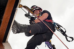 Fire Fighter Darren Monette of the South Yorkshire Fire Service Technical Rescue Unit demonstrates Abseiling Techniques at Aston Park fire station open day on Saturday.113933-02.13 August 2011  Image © Paul David Drabble