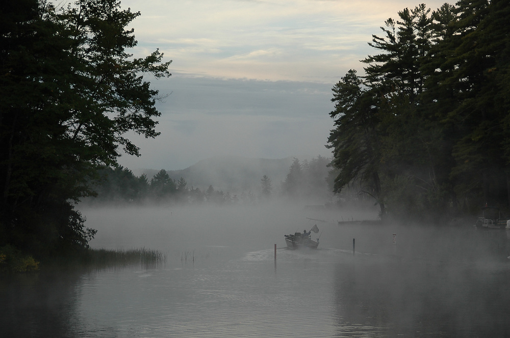 A fisherman heading out early on a misty end of summer morning