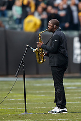 OAKLAND, CA - DECEMBER 09: Saxophonist Mike Phillips performs the National Anthem before the game between the Oakland Raiders and the Pittsburgh Steelers at the Oakland Coliseum on December 9, 2018 in Oakland, California. The Oakland Raiders defeated the Pittsburgh Steelers 24-21. (Photo by Jason O. Watson/Getty Images) *** Local Caption *** Mike Phillips