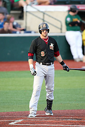 11 August 2012:  Charlie Lisk bats during a Frontier League Baseball game between the River City Rascals and the Normal CornBelters at Corn Crib Stadium on the campus of Heartland Community College in Normal Illinois.  The CornBelters take this game in 9 innings 7 - 2 with a 5 run 2nd inning.