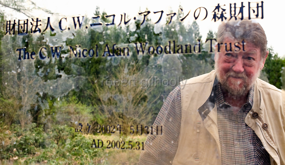 Author and naturalist C.W. Nicol looks at the placard at the entrance to the C.W. Nicol Afan Woodland Trust, native woodland that he began buying up 25 years ago, near his home in Kurohime, Nagano Prefecture, Japan on 10 May 2010..Photographer: Robert Gilhooly
