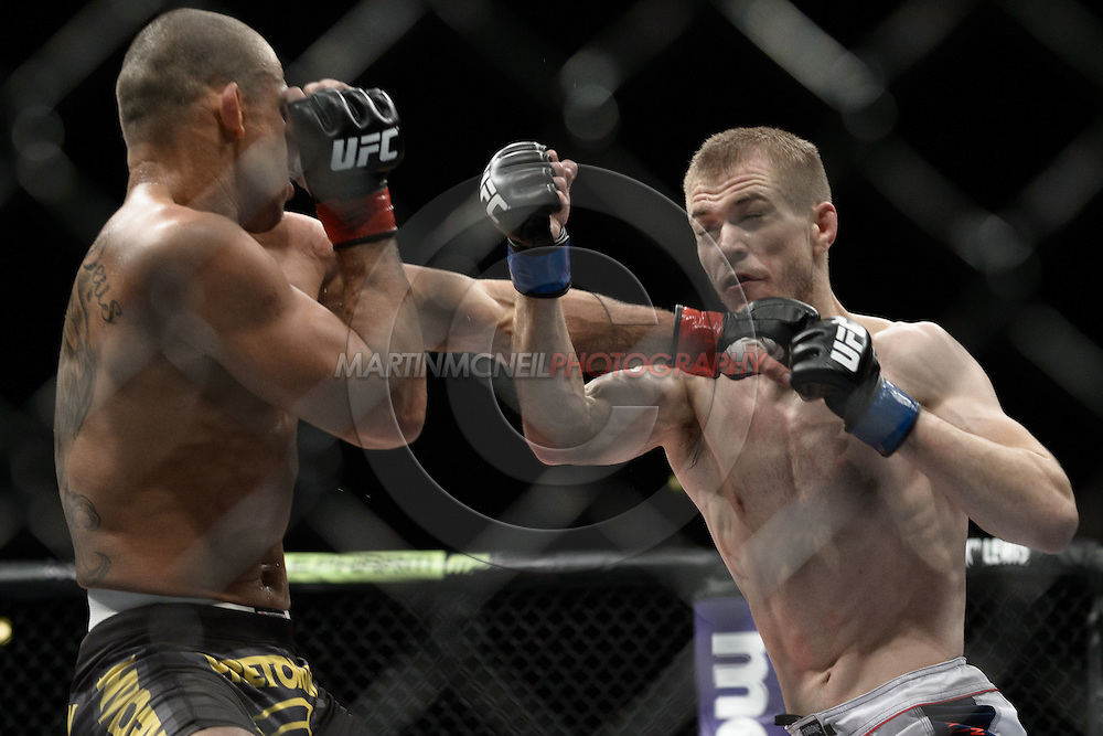 """LONDON, ENGLAND, FEBRUARY 16, 2013: Renan Barao (L) clips Michael McDonald with a left jab during """"UFC on Fuel TV 7: Barao vs. McDonald"""" inside Wembley Arena in Wembley, London on Saturday, February 16, 2013 (© Martin McNeil)"""