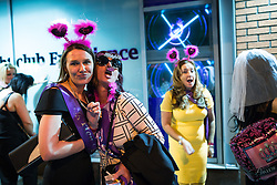"""© Licensed to London News Pictures . Manchester , UK . 05/04/2015 . Women wearing fancy dress outside """" The Birdcage """" on Withy Grove in Manchester City Centre . Revellers on a Saturday night out during the Easter Bank Holiday weekend . Photo credit : Joel Goodman/LNP"""
