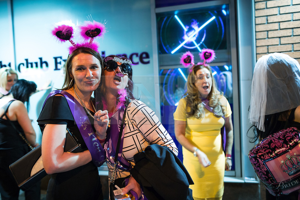 "© Licensed to London News Pictures . Manchester , UK . 05/04/2015 . Women wearing fancy dress outside "" The Birdcage "" on Withy Grove in Manchester City Centre . Revellers on a Saturday night out during the Easter Bank Holiday weekend . Photo credit : Joel Goodman/LNP"