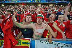LILLE, FRANCE - Friday, July 1, 2016: Wales supporters celebrate the 3-1 victory over Belgium and progression to the Semi-Final during the UEFA Euro 2016 Championship Quarter-Final match at the Stade Pierre Mauroy. (Pic by David Rawcliffe/Propaganda)