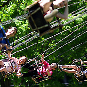 Teenagers and children enjoy the fun rides during the May Fair at Saint Mark's Church, New Canaan, Connecticut, USA. 12th May 2012. Photo Tim Clayton