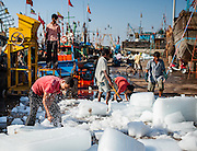 Ice blocks on dock before loading to fishing boat in Diu (India)