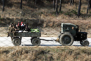 North Koreans ride on a truck carrying cabbages in Mount Kumgang in Kosong, North Korea November 20, 2004. Photo by Lee Jae-Won (NORTH KOREA) www.leejaewonpix.com