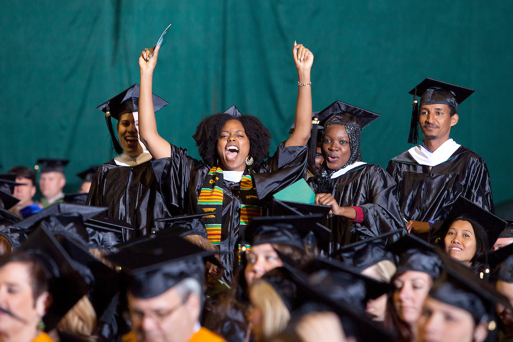 Indigo Goodson cheers after receiving her degree Friday May 2, 2014 at Ohio University's Commencement Ceremony.  Photo by Ohio University / Jonathan Adams