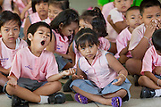 Sept. 23, 2009 -- BANGKOK, THAILAND: Students in an assembly in the Duang Prateep Foundation school in the Khlong Toey slum area in Bangkok. The school is one of several private aid organizations working in the slum providing education and health care for residents. Khlong Toey slum in Bangkok, Thailand, is the largest slum area in Bangkok. Photo by Jack Kurtz