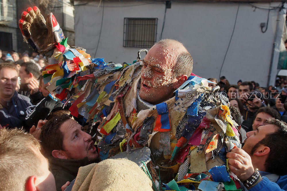 People cheer and lift Raul Beites as he stops for a breath as he makes his way through the streets representing Jarramplas and beating his drum during the Jarramplas Festival on January 20, 2015 in Piornal, Spain. The centuries old Jarramplas festival takes place annually every January 19-20 on Saint Sebastian Day. Even though the exact origins of the festival are not known, various theories exist including the mythological punishment of Caco by Hercules, a relation to ceremonies celebrated by the American Indians that were seen by the first conquerors, to a cattle thief ridiculed and expelled by his village neighbours. It is generally believed to symbolize the expulsion of everything bad. This year the people who represented Jarramplas were Angel Cerro Fernandez on 19 January and Carlos Calle Rodríguez 47 and Raúl Beites Sánchez 34 on 20 January.