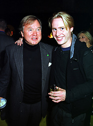 Left to right, SIR ANTHONY BAMFORD and his son MR JOE BAMFORD, members of the JCB diggers family, at a party in London on 21st October 1999.MYB 39