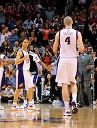 Mar. 23, 2011; Phoenix, AZ, USA; Phoenix Suns guard Steve Nash(15) reacts on the court with teammate center Marcin Gortat (4) while playing against the Toronto Raptors at the US Airways Center. The Suns defeated the Raptors 114-106. Mandatory Credit: Jennifer Stewart-US PRESSWIRE