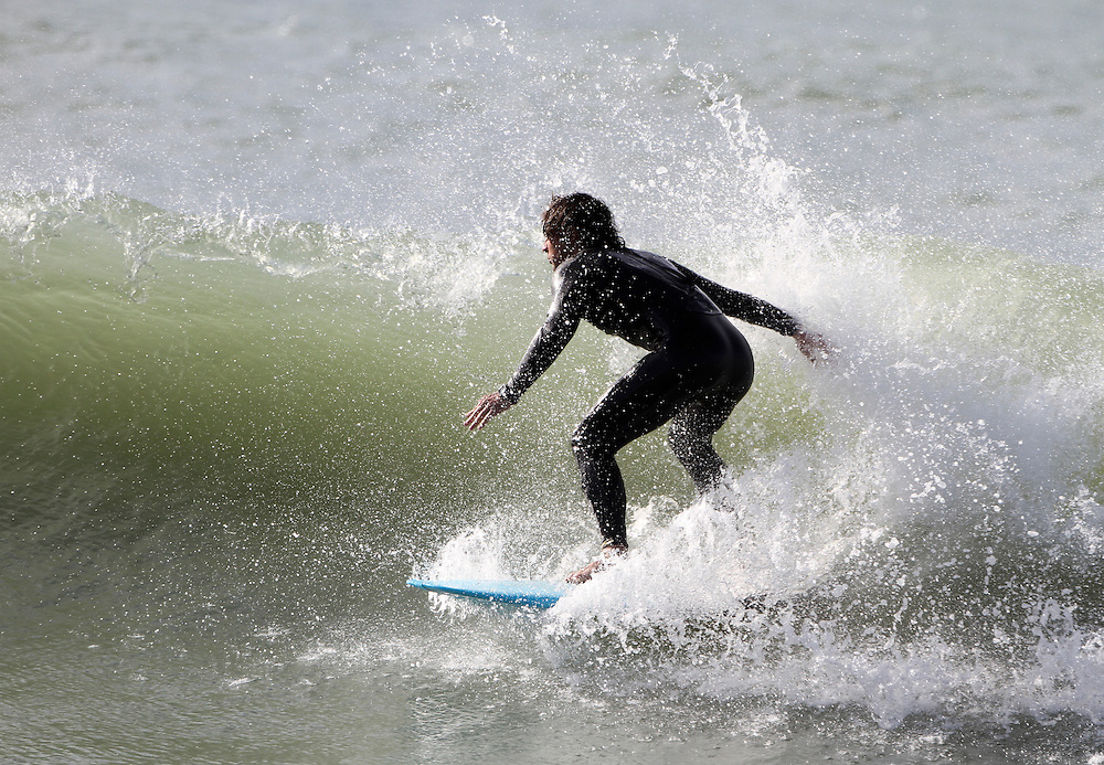 Plenty of local surfers made the most of the great Good Friday weather and waves after the recent storms, Napier, Hawkes Bay, New Zealand, Friday 6 April 2012, Photo: SNPA / John Cowpland
