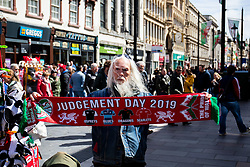 A scarf vendor outside of the stadium<br /> <br /> Photographer Simon King/Replay Images<br /> <br /> Guinness PRO14 Round 21 - Dragons v Scarlets - Saturday 27th April 2019 - Principality Stadium - Cardiff<br /> <br /> World Copyright © Replay Images . All rights reserved. info@replayimages.co.uk - http://replayimages.co.uk