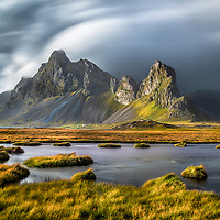Clouds rolling in over the glowing landscape of Iceland.
