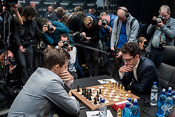 © Licensed to London News Pictures. 26/11/2018. LONDON, UK.  London, UK.  26 November 2018.  Magnus Carlsen (L) of Norway competes against Fabiano Caruana (R) of the United States in the 12th game of the World Chess Championship taking place at The College in Holborn.  The 12 game match is currently tied after 11 draws.  Photo credit: Stephen Chung/LNP