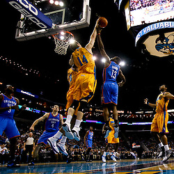 December 10, 2010; New Orleans, LA, USA; New Orleans Hornets power forward Jason Smith (14) blocks a shot by Oklahoma City Thunder guard James Harden (13) during the first half at the New Orleans Arena.  Mandatory Credit: Derick E. Hingle-US PRESSWIRE