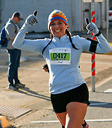Lynn Wilkins gives a smile and two thumbs up as she competes in the Tuscaloosa Half Marathon Saturday, March 4, 2017.  [Staff Photo/Gary Cosby Jr.]