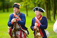 8/18/12 11:25:47 AM - Warwick, PA. -- Chuck Faust (L) of East Greenville, Pennsylvania and Chris Campana of Brick, New Jersey prepare to fire their weapon during a revolutionary war reenactment at the Moland House August 18, 2012 in Warwick, Pennsylvania. -- (Photo by William Thomas Cain/Cain Images)