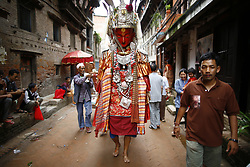 August 19, 2017 - Bhaktapur, Nepal - A Nepalese person concealed inside the idol of Deity Dipankar Buddha parades around the ancient city to receive prayers offered by devotees during Pancha Dan festival in Bhaktapur. The Buddhists observe Pancha Dan by displacing gigantic antique statues of Deity Dipankar Buddha and devotees worshipping them across the city. (Credit Image: © Skanda Gautam via ZUMA Wire)