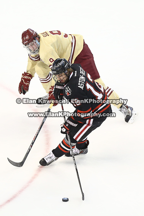 Zach Aston-Reese #12 of the Northeastern Huskies keeps the puck from Brendan Silk #9 of the Boston College Eagles during The Beanpot Championship Game at TD Garden on February 10, 2014 in Boston, Massachusetts. (Photo by Elan Kawesch)