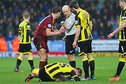 Bradford City defender Tony McMahon protests the challenge on Burton Albion midfielder Tom Naylor during the Sky Bet League 1 match between Burton Albion and Bradford City at the Pirelli Stadium, Burton upon Trent, England on 6 February 2016. Photo by Aaron Lupton.