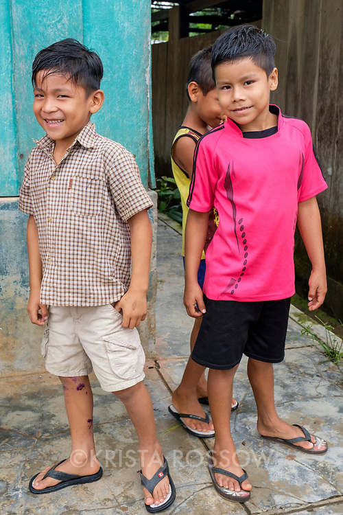 Young boys pose for photographs in the small community of San Francisco de Loreto on the Marañon River in the Peruvian Amazon.