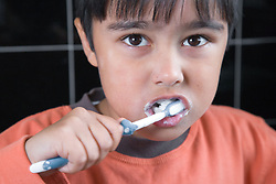 Little boy brushing his teeth,