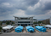 THE BOTH SIDES OF THE DMZ<br /> <br /> I first visited the Demilitarized Zone on the North Korean side in 2008. The DMZ is a 250 km long, 4km wide stretch of land that serves as a buffer zone between North and South Korea.<br /> I came back 5 times there before being banned by the North Korean regim.<br /> I visited the DMZ on the South Korean side twice in 2016 and 2017.<br /> The both sides have huge differences but not in the way you may expect sometimes...<br /> The two Koreas have signed armistice but not peace. The Joint Security Area in Panmunjom is called a &laquo; demilitarized zone &raquo;, but in fact it is the most armed zone in the world and also a major touristic attraction both in North and South with more than 100 000 tourists coming there every year.<br /> <br /> Photo shows:  In Panmunjom, the soldiers from the two countries must remain totally static when they face the other side in the Joint Security Area (JSA).<br /> This attitude may seem very painful but in fact, they are here only when some visitors are coming! When there are no visitors, they go back to their main building, and the place is empty.<br /> &copy;Eric Lafforgue/Exclusivepix Media