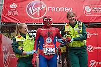 Paul Martelletti of Great Britain breaks the Guinness World Record for the fastest marathon dressed as Spiderman at the Virgin Money London Marathon, Sunday 26th April 2015.<br /> <br /> Scott Heavey for Virgin Money London Marathon<br /> <br /> For more information please contact Penny Dain at pennyd@london-marathon.co.uk