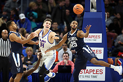 December 27, 2017 - Chicago, IL, USA - DePaul's Marin Maric (34) and Villanova's Mikal Bridges (25) chase a loose ball in the first half on Wednesday, Dec. 27, 2017, at Wintrust Arena in Chicago. Villanova won, 103-85. (Credit Image: © Brian Cassella/TNS via ZUMA Wire)