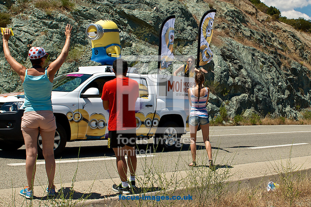 Picture by Ian Wadkins/Focus Images Ltd +44 7877 568959<br /> 30/06/2013<br /> Free gifts are thrown from the publicity 'Caravan' procession as it passes ahead of stage 2 of the 2013 Tour de France in Soveria, Corsica.