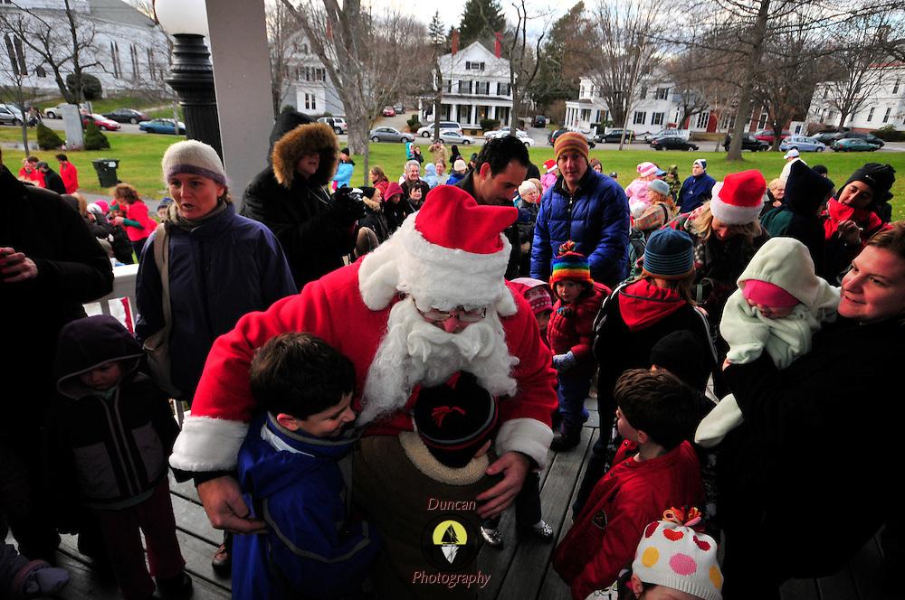 11.28.2009 -- BATH, Maine. Santa greets assembled children and adults at Bath's Gazebo on Saturday afternoon. Santa had planned to hit Brunswick first on Friday, but due to heavy rain, he went to Bath first and then returned to Brunswick on Sunday. Photo by Roger S. Duncan.